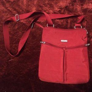 A red Baggallini crossbody purse